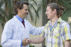 Doctor patient handshake Royalty Free Stock Image