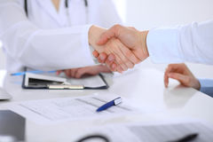 Doctor and patient handshaking. Hands close-up Stock Photo