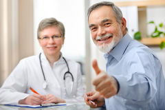Doctor and patient. Happy senior patient and doctor at the doctor's office Royalty Free Stock Photo