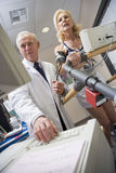 Doctor With Patient During Health Check royalty free stock photography