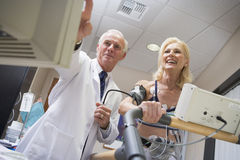 Doctor With Patient During Health Check Stock Photo