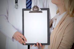 Doctor and patient holding clipboard free copy space. Medical ethics and trust concept Royalty Free Stock Image