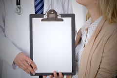 Doctor and patient holding clipboard free copy space. Medical ethics and trust concept.  Stock Photo