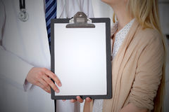 Doctor and patient holding clipboard free copy space. Medical ethics and trust concept Stock Images