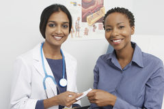 Doctor And Patient Holding Prescription Stock Photography
