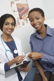 Doctor And Patient Holding Prescription Stock Photos