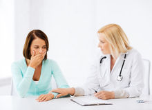 Doctor with patient in hospital Stock Photography