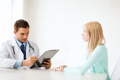 Doctor with patient in hospital Royalty Free Stock Photos