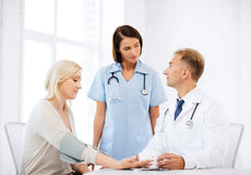 Doctor and patient in hospital Stock Image