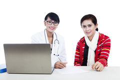 Doctor and patient interaction using laptop Royalty Free Stock Photo