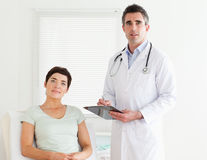 Doctor and patient looking into a camera Stock Photos