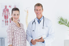 Doctor and patient looking at camera Royalty Free Stock Images