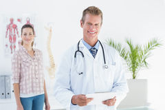 Doctor and patient looking at camera Stock Photography