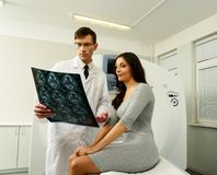 Doctor with patient looking at the computed tomography results Royalty Free Stock Photos