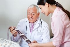 Doctor And Patient Looking At Ultrasound Print Stock Photography