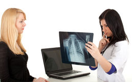 Doctor with patient looking at x-ray chest Stock Photos