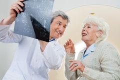 Doctor With Patient Looking At X-ray Royalty Free Stock Photos