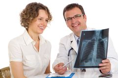 Doctor and patient looking an x-ray image Royalty Free Stock Photography