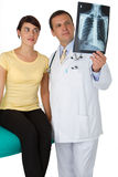 Doctor and patient looking an x-ray image Stock Photos
