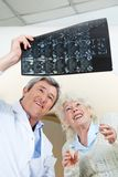 Doctor And Patient Looking At X-ray Royalty Free Stock Image