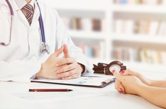 Doctor and patient medical consultation. Doctor patient health care office desk stethoscope medical concept royalty free stock photo