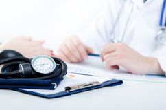 Doctor and patient medical consultation. Doctor patient health care office desk stethoscope medical concept Stock Photo