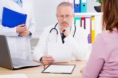 Doctor and patient in medical office copy space stock image