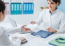 Doctor and patient meeting in the office royalty free stock photography