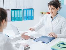 Doctor and patient meeting in the office stock images