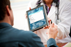 Doctor: Patient Needs to Fill Out Medical Form on Tablet Compute Stock Photos