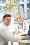 Doctor and patient in office Stock Photos