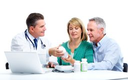 Doctor and patient senior couple. Stock Photography