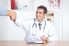 Doctor And Patient Shake Hands Royalty Free Stock Photos