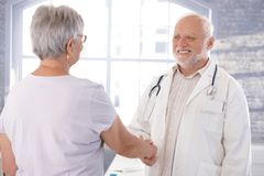 Doctor and patient shaking hands Stock Images