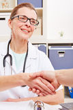 Doctor and patient shaking hands Royalty Free Stock Image