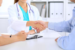 Doctor and patient are shaking hands Royalty Free Stock Images