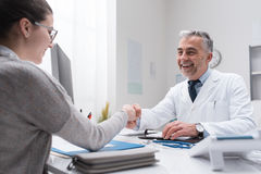 Doctor and patient shaking hands Royalty Free Stock Photo