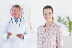 Doctor and patient smiling at camera Stock Images