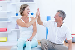 Doctor and patient smiling at each other. In medical office Stock Photo