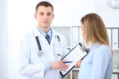 Doctor and  patient  standing straight an speaking.. Medicine and health care concept Royalty Free Stock Photos