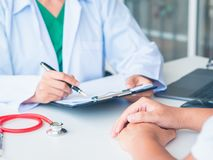 Doctor and Patient are talking in the hospital. Health care and royalty free stock images