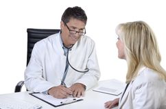Doctor and patient talking in meeting Stock Image