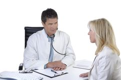 Doctor and patient talking in meeting Royalty Free Stock Photos