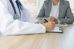 Doctor and patient. Doctor to patient diagnosis and treatment Stock Photo