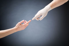 Doctor and Patient Touching Hands royalty free stock photos
