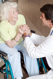 Doctor with Patient on Wheel Chair Royalty Free Stock Image