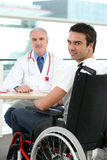 Doctor with patient in a wheelchair Stock Photo