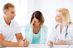 Doctor with patients in cabinet Stock Photo