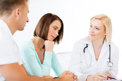 Doctor with patients in cabinet Royalty Free Stock Photography