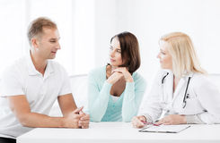 Doctor with patients in cabinet Stock Images
